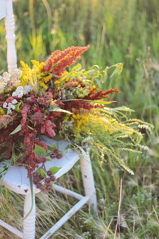 Foraged Prairie Wildflower Bouquet on a White Antique Chair in a Field   Calgary, Alberta, Canada // JustineCelina.com