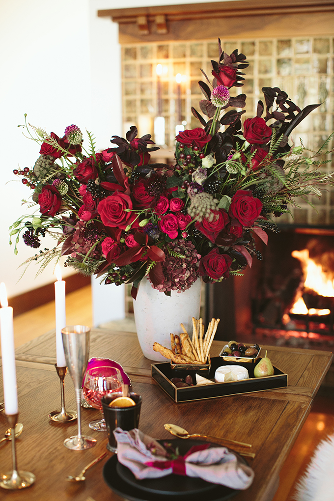 Luxe Holiday Floral Inspiration   Moody Winter Flower Arrangement with Black Magic Roses, Black Baccara Roses Gem and Lace Spray Garden Roses, Liqustrom, Hypericum, Allium, Lisianthus, Scabiosa, Chocolate Lace, Cotinus, Photina and Grevillea by Rebecca Dawn Design // JustineCelina.com