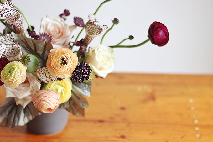 Bringing Autumn Flowers Into Your Home   A Moody, Autumn Arrangement including Ranunculus, Mother of Pearl Roses, Astrantia, Scabiosa, Saracena Lily, Poppy Pods and Angel Wings Begonia Leaves // JustineCelina.com + Rebecca Dawn Design