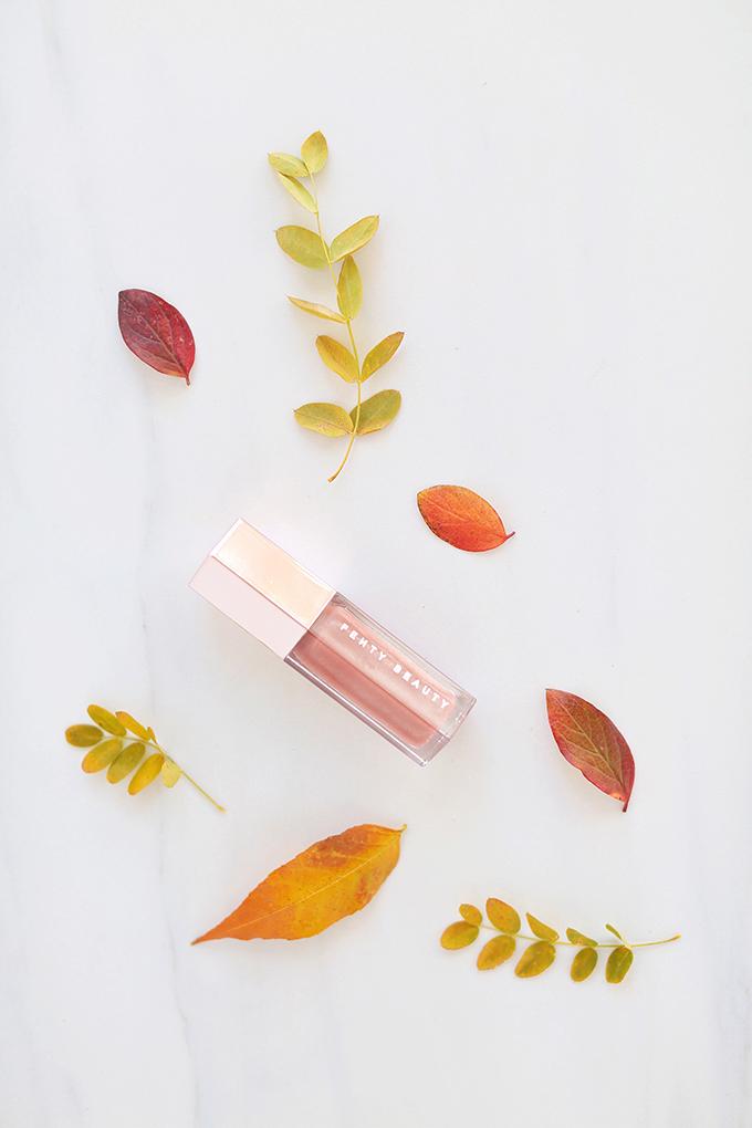FENTY BEAUTY by Rihanna Gloss Bomb Universal Lip Luminizer in Fenty Glow   September 2017 Beauty Favourites // JustineCelina.com