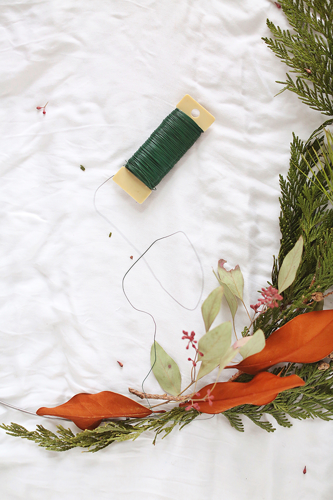 DIY   Asymmetrical Holiday Wreath   How to Make an Asymmetrical Holiday Wreaths for Christmas with Pine, Cedar, Brunia, Eucalyptus pods, Red Ironbark Eucalyptus and Magnolia   Christmas Wreath DIY   Modern Christmas Wreath DIY // JustineCelina.com