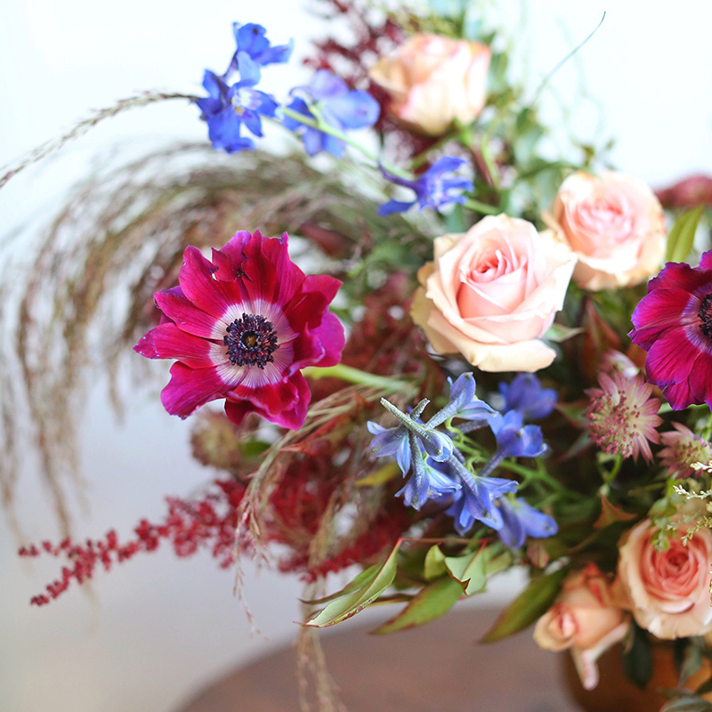 A PANTONE 2018 Ultra Violet Inspired Arrangement with Anemones, Spray Roses, Bella Donna, Dephinium, Astrantia, Astilbe, Sedum, Ruby Silk Grass, Nandina, Umbrella Fern and Knife blade Acacia // JustineCelina.com x Rebecca Dawn Design