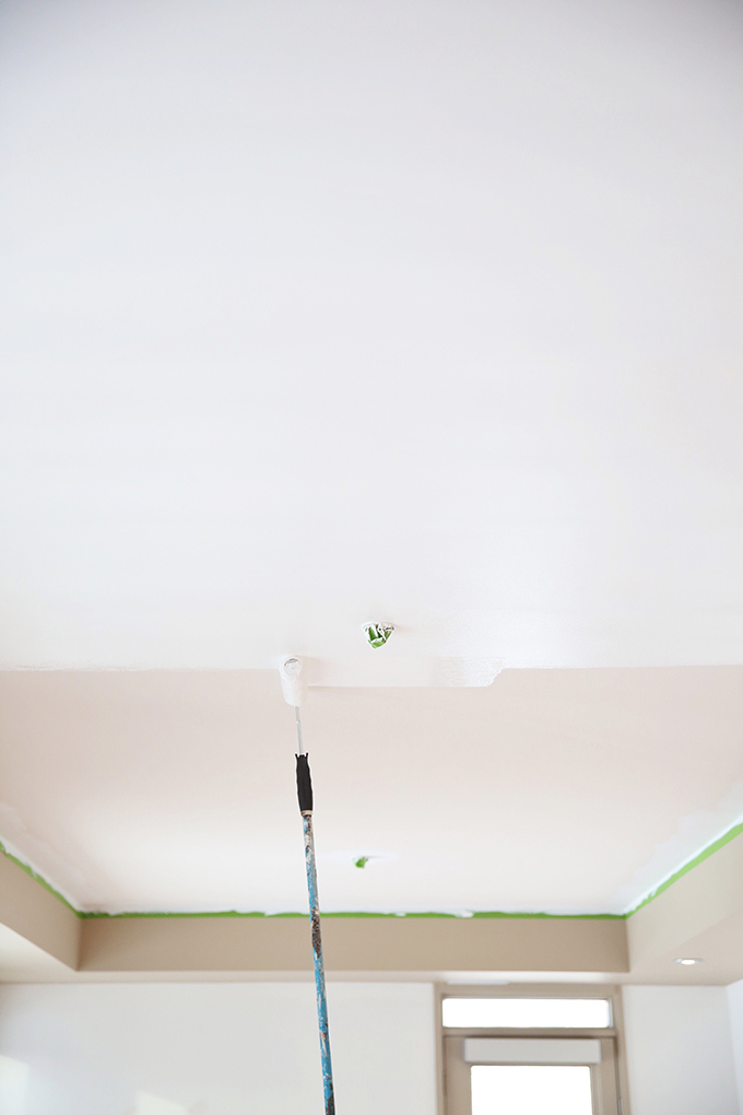 Space Refresh   Paint Transformation   From Builder's Beige to Behr Ultra Pure White   DIY A Professional Quality Paint Job   How to Paint Ceilings White // JustineCelina.com