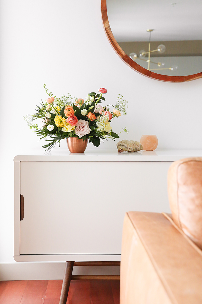 How to Unite a Space With Flowers | A Cheerful Spring Arrangement featuring Hyacinths, Double tulips, Ranunculus, Larkspur, Queen Anne's Lace, Quicksand roses, Lisianthus, Camellia, Willow Eucalyptus and Podocarpus created by Rebecca Dawn Design // JustineCelina.com