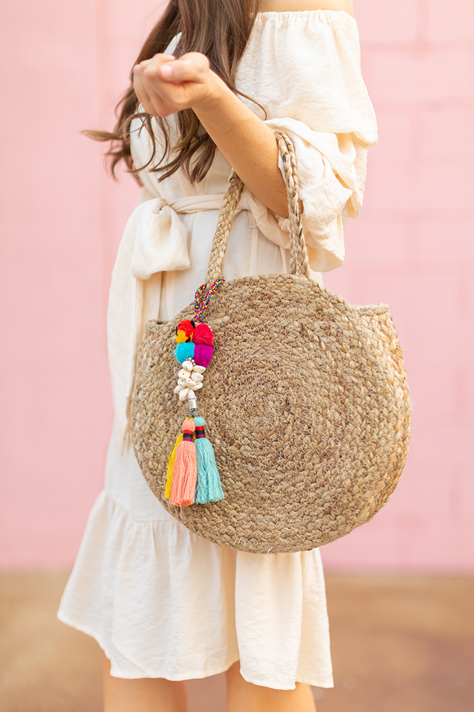 The Accessory Edit | Natural Material Bags | Zara Circular Straw Bag with Pom Poms and Tassels | How to Style Straw Bags | The Best Straw Bags 2018 // JustineCelina.com