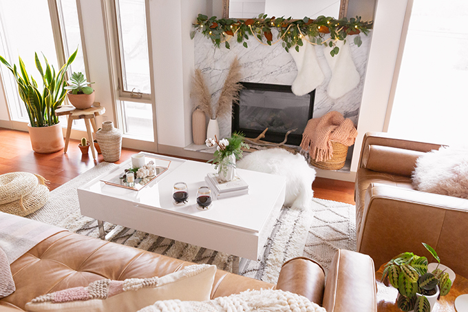 Apartment Friendly Modern Holiday Decor | Simple Holiday Arrangement on a Coffee Table with Greenery and Cotton Stems and 2 glasses of red wine | Bohemian, Mid Century Modern Holiday Decor | Bohemian Holiday Home Tour 2018 | Canadian Tire CANVAS Ornaments // JustineCelina.com