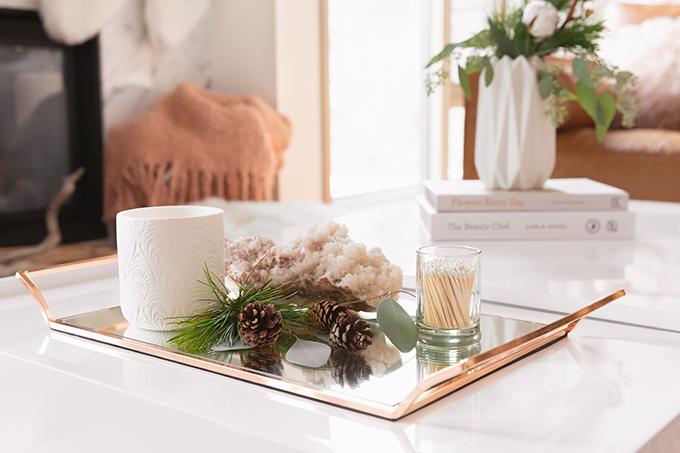 Apartment Friendly Modern Holiday Decor | Simple Holiday Coffee Table with Candles, Quartz, Fresh Greenery and Pinecones | Bohemian, Mid Century Modern Holiday Decor | Bohemian Holiday Home Tour 2018 | Canadian Tire CANVAS Ornaments // JustineCelina.com