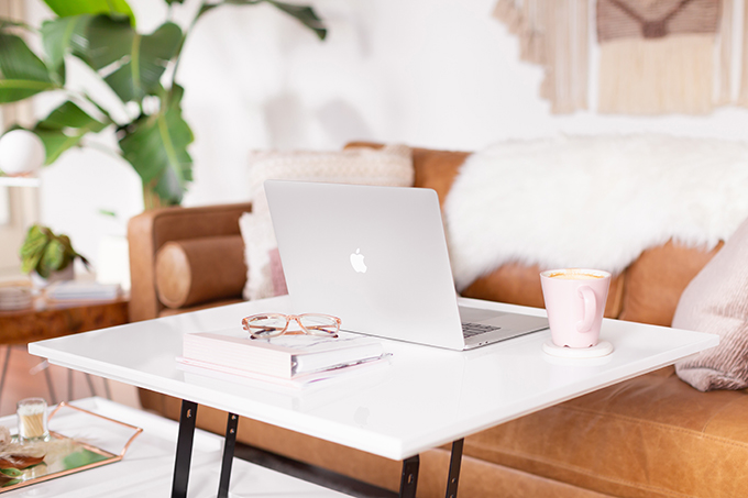 2018 Rewind + 2019 Goals | Calgary Lifestyle Blogger | Casual Home Office | Entrepreneur Working from Home | Goal Setting for 2019 | MacBook Pro on white table with glasses, planners and coffee in bohemian, mid century modern apartment // JustineCelina.com
