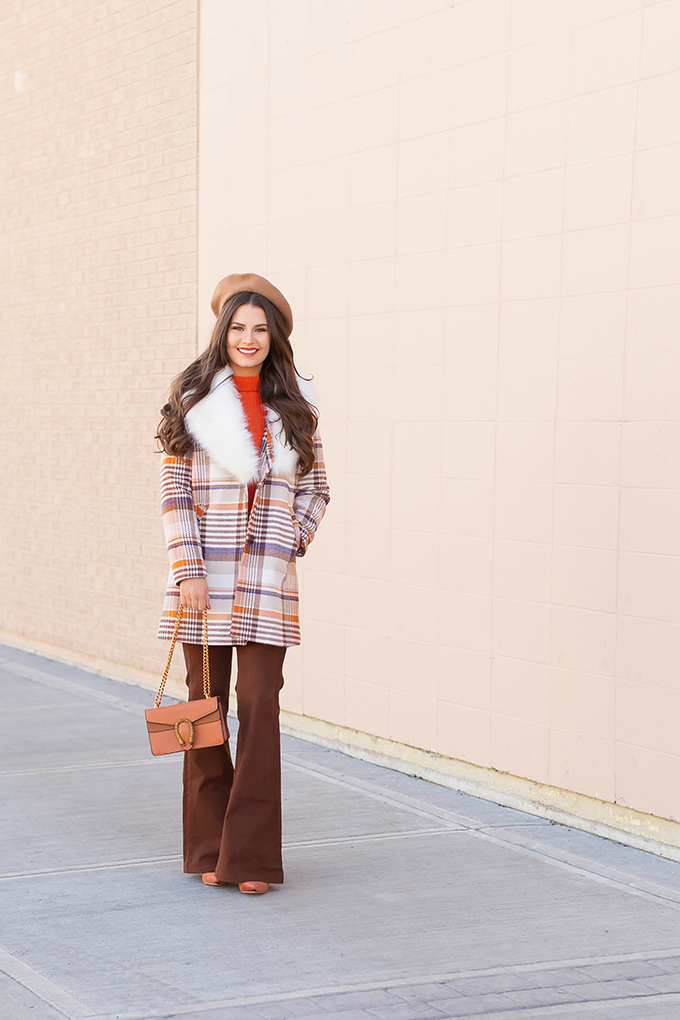 Winter 2019 Lookbook   Apres Ski: A fun, 70's Inspired Look   How to Style Flared Jeans for Winter   A plaid coat with a faux fr collar styled with an orange knit sweater, brown flared jeans, velvet ankle booties and a Brown Gucci Dionysus Small Shoulder Bag   Bohemian Winter Style Ideas   How to Wear the 70's Trend in 2019   Calgary, Alberta, Canada Fashion & Lifestyle Blogger // JustineCelina.com