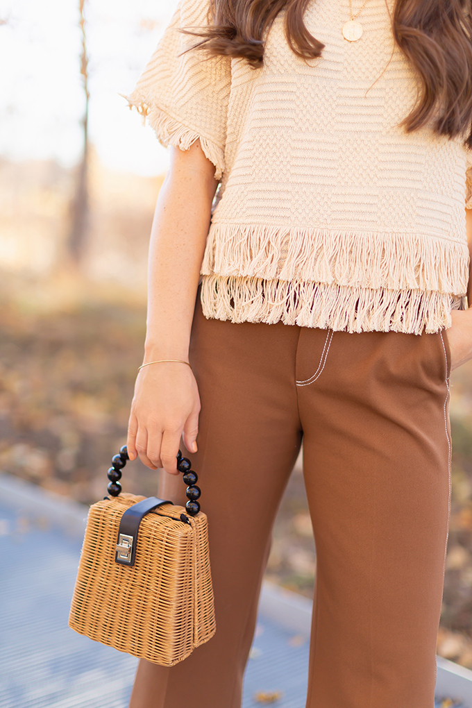 WORK WEAR | SPRING 2019 TRENDS AT THE OFFICE | How to Style Culottes for the Office | Brown 70's Style Culottes with a Mustard Faux Suede Jacket, Knit Fringe Hem Top, Natural Material Zara Rattan Woven Box Bag and Leopard Print D'Orsay Heels | Spring 2019 Trends | Office Appropriate Spring Outfit Ideas // JustineCelina.com