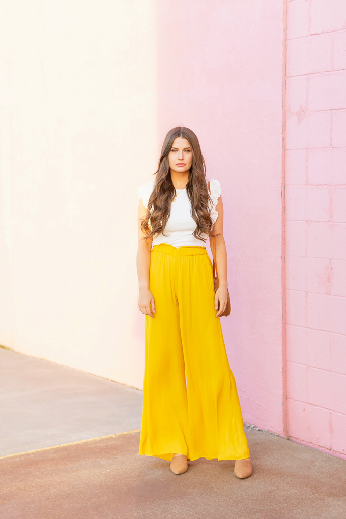 SPRING/SUMMER 2019 LOOKBOOK | Mellow Yellow: How to Style Yellow Palazzo Pants for Spring | Palazzo Pant Outfit Ideas Spring 2019 | Spring/Summer Summer Vacation Outfit Ideas | Brunette woman wearing a Yellow Palazzo Pants, a white ruffled sleeve top, a Round Women Bali Round Rattan Bag and Camel Mules | How to Wear palazzo pants for spring 2019 | Top Spring/Summer 2019 Trends and how to wear them | Calgary Fashion & Lifestyle Blogger // JustineCelina.com