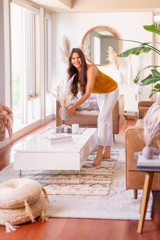 MidSummer Space Refresh Update | Smiling brunette woman with a dried Pampas Grass Arrangement in bright and airy mid century modern living room during the summer | JustineCelina's Inner City Calgary bohemian, mid-century modern apartment | A Bohemian, Mid-Century Modern Living Room featuring Pampas Grass and a Mature Bird of Paradise Plant | Summer Decor 2019 Trends | Bohemian, Mid Century Modern Decor | Mature Bird of Paradise Plant | Calgary Lifestyle, Interior Design and Home Decor Blogger // JustineCelina.com