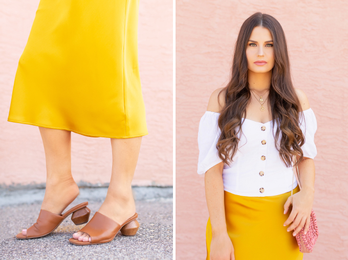 LATE SUMMER 2019 LOOKBOOK | Walking on Sunshine: How to Style TopShop's Bias Cut Satin Midi Skirt for Summer / Autumn | TopShop Yellow Satin Skirt Outfit Ideas | Casual Daytime Transitional Outfit Ideas | Brunette woman wearing a Topshop Yellow Satin Midi Skirt styled with a white button-down Bardot top, brown leather mules with a wooden heel and a Pantone Living Coral beaded bag | Summer 2019 Trends | Calgary Fashion & Creative Lifestyle Blogger // JustineCelina.com