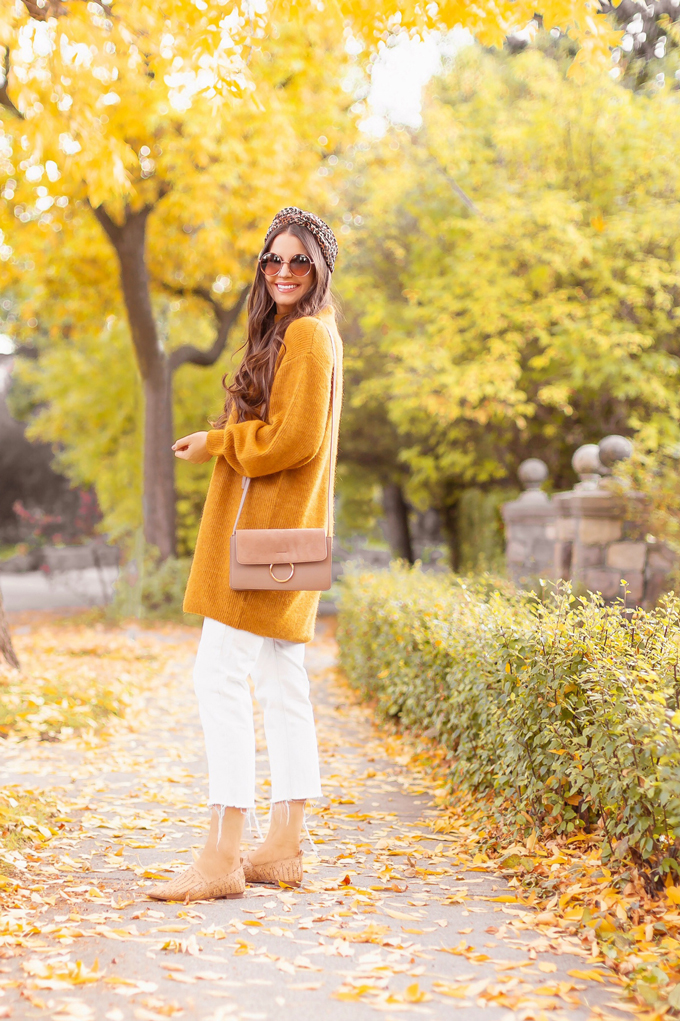 Summer to Fall 2019 Transitional Lookbook | Top Summer to Fall 2019 Transitional Trends | Top Autumn 2019 Trends and How to Wear Them | Fall 2019 Casual Outfit Ideas | Brunette woman wearing an oversized mustard sweater, crop white jeans, Joe Fresh light brown Mixed Media Crossbody Bag, Mango babouches, Round sunglasses and a leopard print turban style headband | Top Calgary Fashion & Creative Lifestyle Blogger // JustineCelina.com