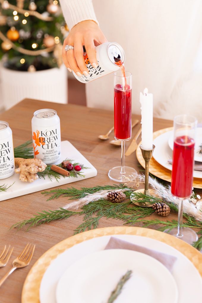 Easy Holiday Entertaining Ideas | Holiday Entertaining at Home | Stress Free Entertaining Tips | Holiday Cocktail Party | Easy Christmas Party Ideas | Simple Mid Century Modern Holiday Dinner Party | JustineCelina's Mid Century Modern Bohemian Dining Room & Bar | Simple Festive Tablescape with Winter Greenery, Pampas Grass, Candles and Berry Hibiscus Kombrewcha | Kombrewcha available in Alberta | Kombrewca Review | Calgary Home Decor & Entertaining Blogger // JustineCelina.com