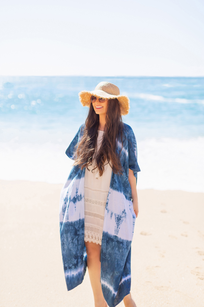 Resort 2020 Lookbook | Tropical Vacation Outfit Ideas | Cute Beach Vacation Outfits 2020 | Mexico Vacation Outfits | What to Wear on Vacation 2020 | How to Style Tie Dye | Tie Dye Outfit Ideas | The Best Beach Dresses & Coverups | Pantone 2020 Color of the Year Classic Blue Tie Dye Kimono | Brunette Woman wearing a white bikini cover-up, tie dye kimono and frayed brim straw hat | Camino Real Zaashila, Huatulco 2020 Review | Tangolunda Bay | Calgary Fashion & Travel Blogger // JustineCelina.com