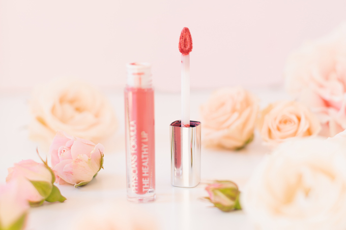 My Top 5 Rose Toned Lipsticks | JustineCelina's most worn lipsticks | JustineCelina's favourite lipsticks | Beauty Blogger's Favourite Lipsticks | The best rose Lipsticks | Best Rose Colored Lipstick Drugstore | Pink Lipstick for Medium Skin | Best Lipsticks Spring 2020 | Physician's Formula The Healthy Lip Velvet Liquid Lipstick in Coral Minerals Photos, Review, Swatches | Spring Drugstore Liquid Lipstick surrounded by roses | Calgary Beauty & Lifestyle Blogger // JustineCelina.com