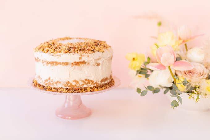 A Simple Easter Dinner for Two | Easter Vegan, Gluten and Oil Free Carrot Cake on a blush cakestand | Easter 2020 | Easter Entertaining at Home | Healthy Easter Carrot Cake | Easter Flowers | Easter Floral Centrepieces | Fresh Spring Flowers | Calgary Lifestyle and Decor Blogger // JustineCelina.com