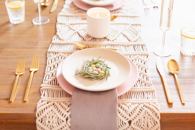 A Simple Easter Dinner for Two | JustineCelina's Mid Century Modern Bohemian Dining Room Set for Easter | Easter Table Setting with a Rosemary and Mini Egg Birds Nest, Pastel Dinnerware, Champagne Flutes, Lemon Water, Gold Flatware, a Candle and Macrame Table Runner | Easter 2020 | Easter Entertaining at Home | Easter Floral Centrepieces | Easy Easter Decor Ideas | Mid Century Modern Easter Decor | Easy Easter Table Settings | Calgary Lifestyle and Decor Blogger // JustineCelina.com
