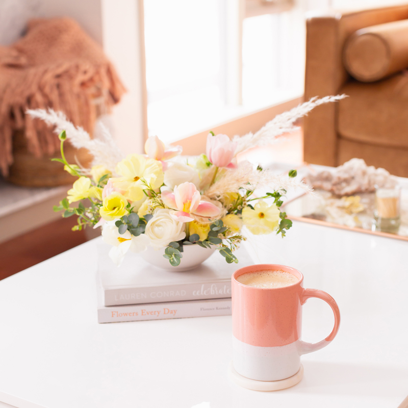 April 2020 Soundtrack | Chill Spring 2020 Playlist | Calm Spring 2020 Playlist Spotify | Inspiring Spring 2020 Playlist | Uplifting Spring 2020 Playlist | Quarantunes | JustineCelina's Inner City Calgary bohemian, mid-century modern Living Room | Cheerful Pastel Spring Flower Arrangement with Pampas Grass, with a Cup of Coffee in a Pink Mug Calgary on a White Coffee Table with a Stack of Books | Calgary Lifestyle Blogger // JustineCelina.com