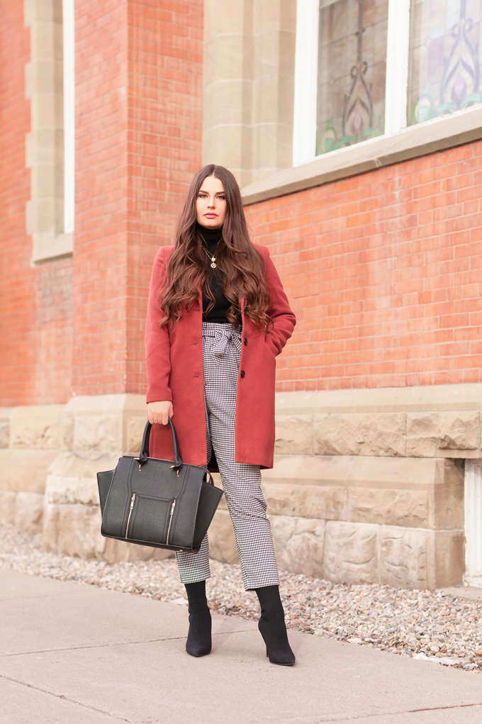WINTER / SPRING 2020 LOOKBOOK | Boss Babe | Brunette woman wearing a Vero Moda Rust Dress Coat, H&M Houndstooth Paperbag Pants, Black Saks 5th Avenue Cashmere Turtleneck, Lulus Back Wing Woman Handbag and Zara Black Sock Boots | Professional Winter to Spring Outfit Ideas | Top Transitional Winter to Spring 2020 Trends | Canadian Winter / Spring Lookbook | How to Wear Spring 2020's Mini Dress | Transitional Winter to Spring Fashion for Canadians // JustineCelina.com