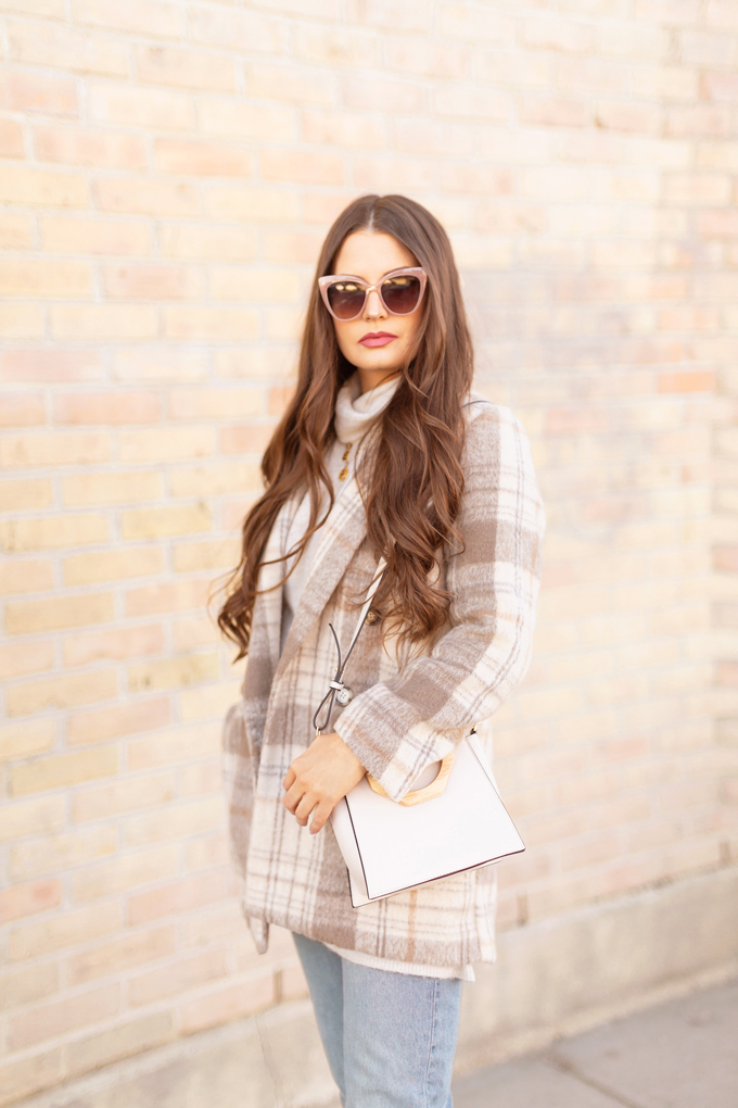 WINTER / SPRING 2020 LOOKBOOK | In Neutral | Brunette woman wearing a H&M Tan and Cream Checked Blazer, H&M Longline Cream Fine Knit Sweater, Zara Light Vintage Wash Mom Jeans, TopShop Cream Wooden Top Handle Bag and Zara Nude Cat Eye Sunglasses | Casual Winter to Spring Outfit Ideas | Top Transitional Winter to Spring 2020 Trends | Canadian Winter / Spring Lookbook | How to Wear Spring 2020's Mini Dress | Transitional Winter to Spring Fashion for Canadians // JustineCelina.com