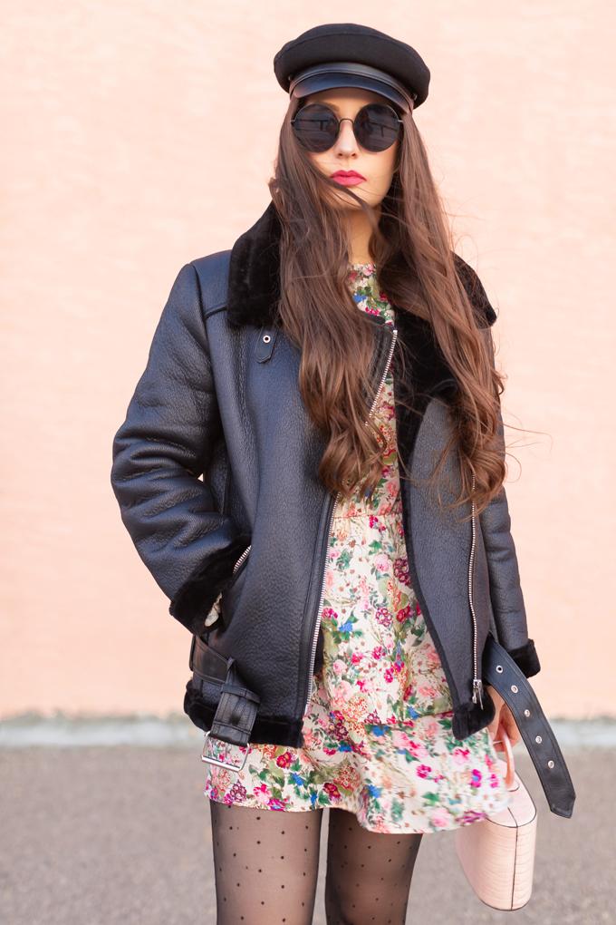 WINTER / SPRING 2020 LOOKBOOK | Rebel Florals | Brunette woman wearing a Zara Full Sleeve Print Dress with a Faux Fur Lined Black Biker Jacket, Black Faux Leather Brimmed Baker Boy Hat, Blush Croc Embossed Bag | Black Circular Sunglasses, Sheer Polka Dot Tights an H&M Black Faux Suede Knee-high Boots | Top Transitional Winter to Spring 2020 Trends | Canadian Winter / Spring Lookbook | How to Wear Spring 2020's Mini Dress | Transitional Winter to Spring Fashion for Canadians // JustineCelina.com