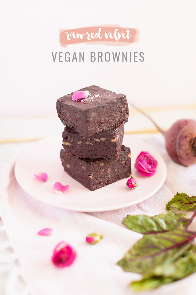 Raw Red Velvet Vegan Brownies | The Best No Bake Vegan Brownies | Healthy Vegan Brownies | Vegan Brownies With Dates | Chewy Fudgy Vegan Brownie Recipe | Easy Vegan Brownies | Red Velvet Beet Brownies | Gluten Free Vegan Chocolate Brownies | Medjool Date Brownies | Decadent Dark Chocolate Vegan Brownies | Raw Vegan Desserts | Shredded Beet Brownies | A stack of 3 brownies on blush pink plates with pink roses and organic leafy beets | Calgary Plant Based Lifestyle Blogger // JustineCelina.com
