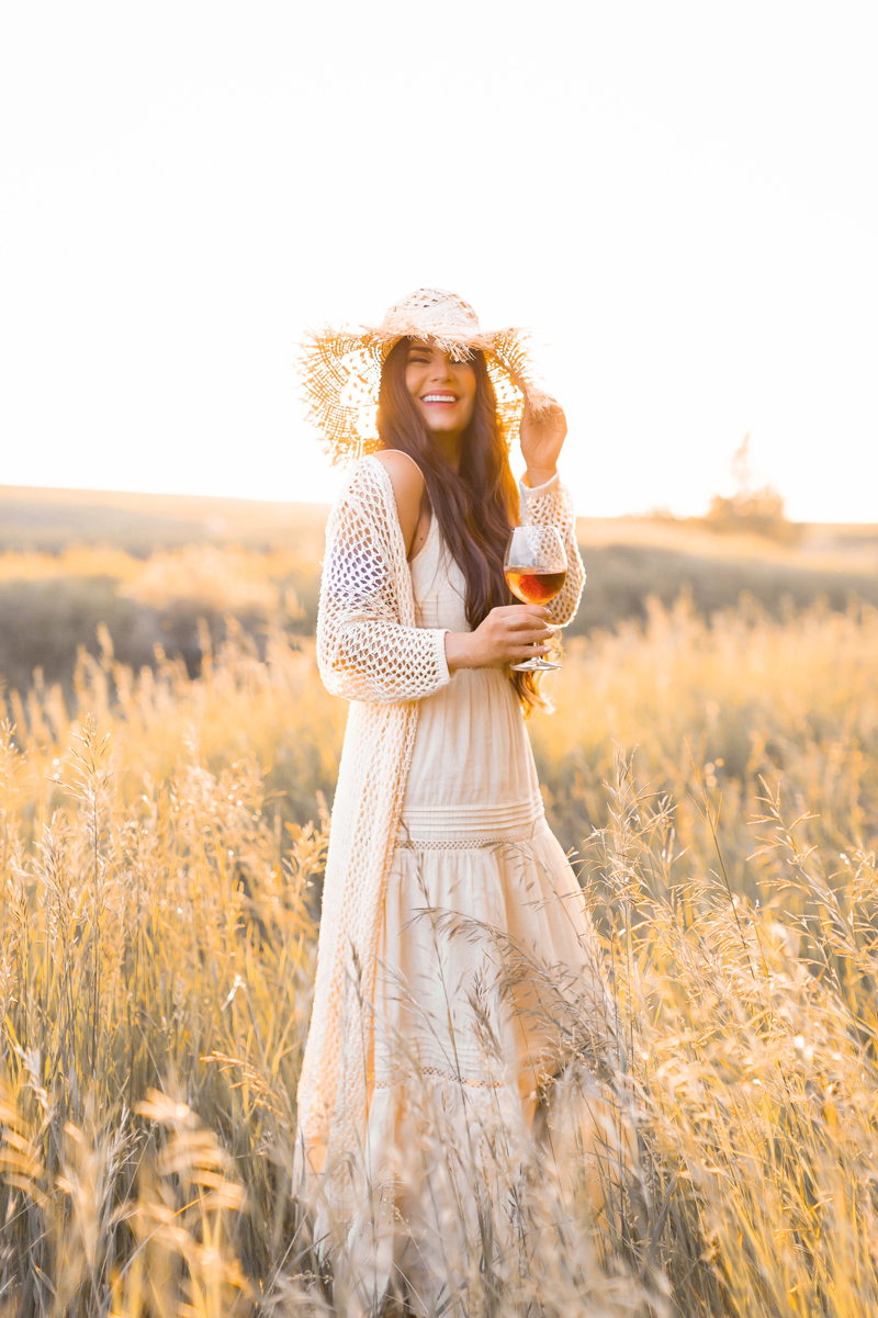 June 2020 Soundtrack   Chill Summer Playlist   Inspiring Summer Playlist Spotify   Laughing brunette woman enjoying a glass of rosé wine in a sunlit prairie wheat field at sunset   JustineCelina's childhood home in Wheatland County, Alberta   Summer 2020 Bohemian Style Ideas   Boho Casual Summer Dresses   Summer 2020 Fashion   Best H&M Dresses Summer 2020   How to Style a Frayed Brim Straw Hat   Calgary, Alberta, Canada Creative Lifestyle Blogger and Entrepreneur// JustineCelina.com