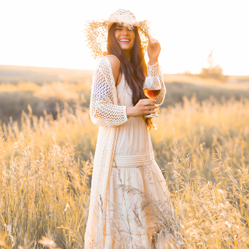June 2020 Soundtrack | Chill Summer Playlist | Inspiring Summer Playlist Spotify | Laughing brunette woman enjoying a glass of rosé wine in a sunlit prairie wheat field at sunset | JustineCelina's childhood home in Wheatland County, Alberta | Summer 2020 Bohemian Style Ideas | Boho Casual Summer Dresses | Summer 2020 Fashion | Best H&M Dresses Summer 2020 | How to Style a Frayed Brim Straw Hat | Calgary, Alberta, Canada Creative Lifestyle Blogger and Entrepreneur// JustineCelina.com