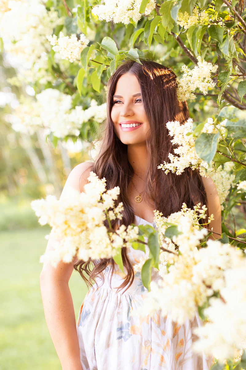 Summer 2020 Lookbook   Boho Summer 2020 Outfit Ideas   Summer Capsule Wardrobe   Summer Quarantine Outfits   Classic Summer Outfit Ideas   The Best Linen Dresses 2020   The Best Little White Dresses 2020   Classic Linen Sundress   Lilac Tree Photoshoot   Summer Outfit Ideas   Classic Affordable Summer Style   Summer 2020 Trends   Smiling brunette woman wearing H&M's Linen-Blend Dress in Cream/Floral in a Japanese Lilac Tree   Pastel Watercolour Floral Sundress    Calgary Alberta Fashion Blogger // JustineCelina.com