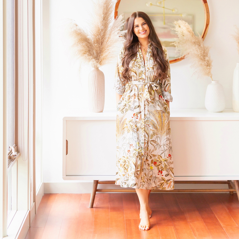 Meet Justine // Justine Celina Maguire | Top Calgary Lifestyle Blogger | Justine Celina Maguire Living Room Summer Meets Fall 2020 | Justine Celina Maguire's Mid Century Modern, Bohemian Apartment in Calgary, Alberta, Canada | JustineCelina Studio | Smiling brunette woman wearing a button down botanical print dress standing infront of Structube's Ocean Sideboard | Pampas Grass Decor Summer Autumn 2020 | Calgary, Alberta, Canada Creative Lifestyle Blogger and Entrepreneur // JustineCelina.com