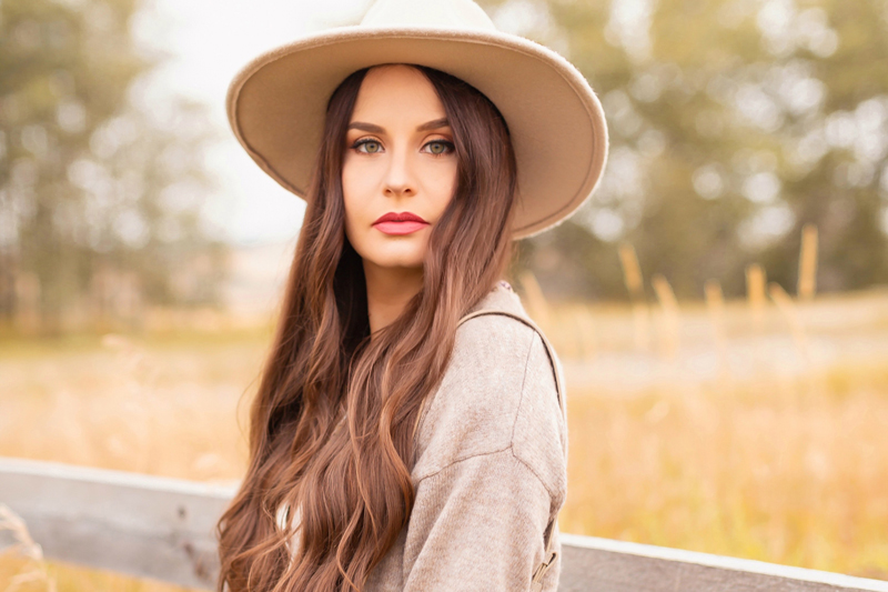 Early Autumn 2020 Lookbook | Country Checks | Brunette woman wearing a taupe flat brimmed hat and taupe cardigan next to an weathered fence in the prairies | Boho Fall 2020 Outfit Ideas | Top Fall 2020 Trends | How to Style Midi Dresses for Fall | Bohemian Fall outfit Ideas | How to Wear Florals in Fall | The Best Fedoras 2020 | How to Style a Flat Brim Hat | Cottagecore Fall Outfit Ideas | Calgary Alberta Fashion & Lifestyle Blogger // JustineCelina.com
