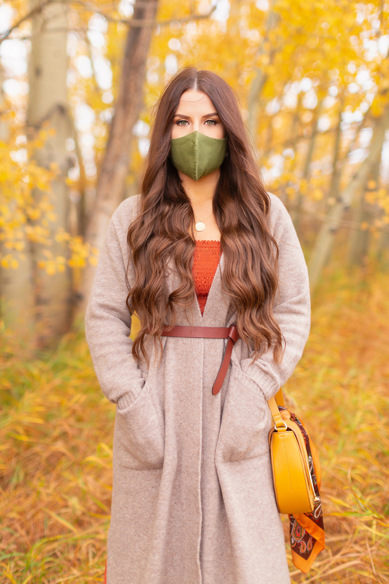 Early Autumn 2020 Lookbook | Cozy Coatigan | Brunette woman wearing a beige coatigan, cognac tie-detail belt, rust smocked peasant sleeve dress and an olive green linen non-medical face mask during the fall | Top Fall 2020 Trends | Boho Fall 2020 Outfit Ideas | Top Fall 2020 Trends | How to Style a Coatigan | The Best Non-Medical Linen Face Masks | Bohemian Fall outfit Ideas | Cottagecore Fall Outfit Ideas | Calgary Alberta Fashion & Lifestyle Blogger // JustineCelina.com