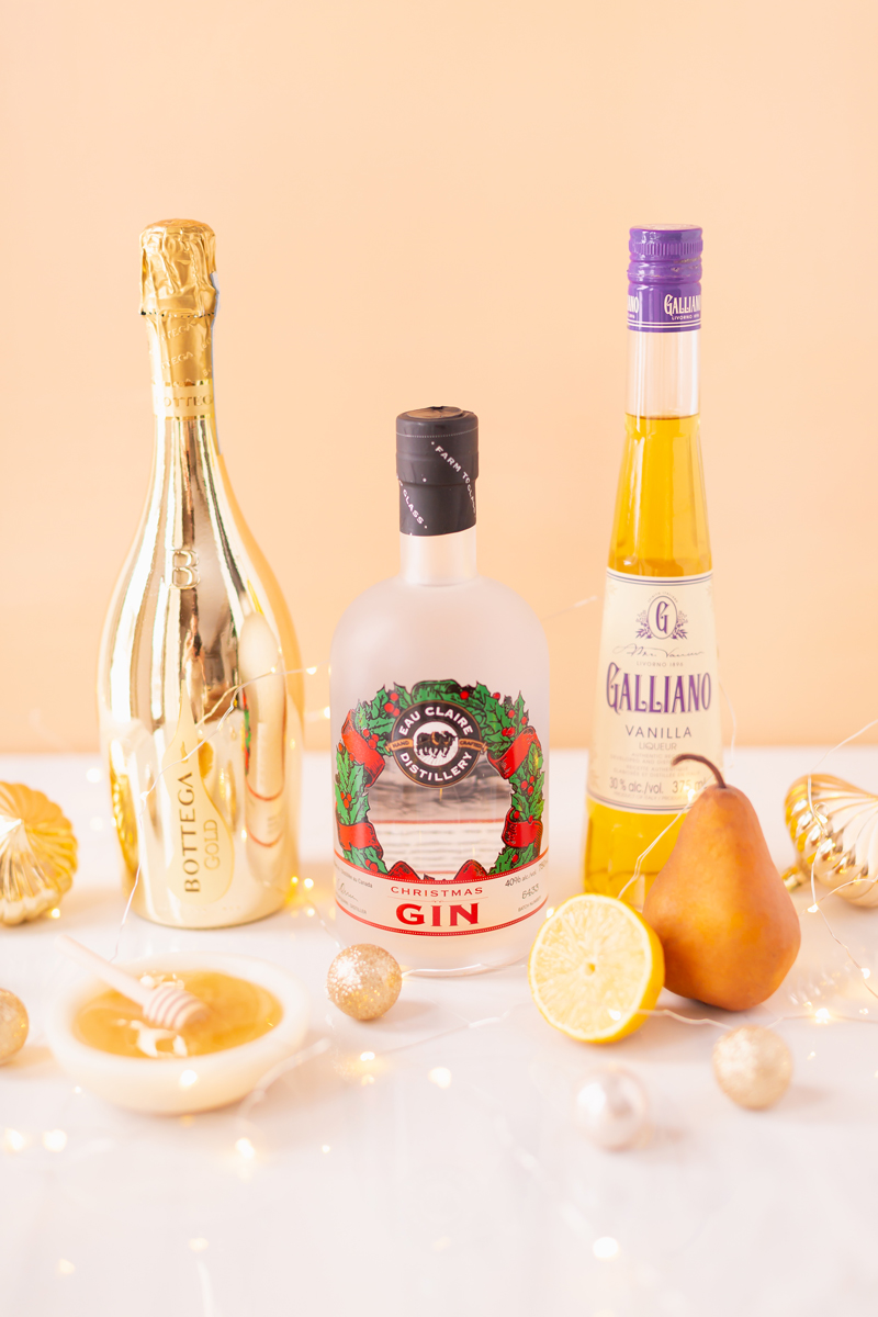 Gilded Vanilla Pear Sparkler Ingredients | A glitzy, French 75 inspired New Years Eve cocktailfeaturing 24 karat gold infused gin, Brut Prosecco, Italian vanilla liqueur, lemon juice andHoneyed Vanilla Pear Syrup | Best NYE 2020 cocktails | How to Make sparkling NYE cocktails at home | Champagne cocktail recipe | Champagne Christmas drinks | New Years Eve Sparklers | Modern Refined Sugar Free French 75 | Honey French 75 | Calgary Creative Lifestyle & Cocktail Blogger // JustineCelina.com