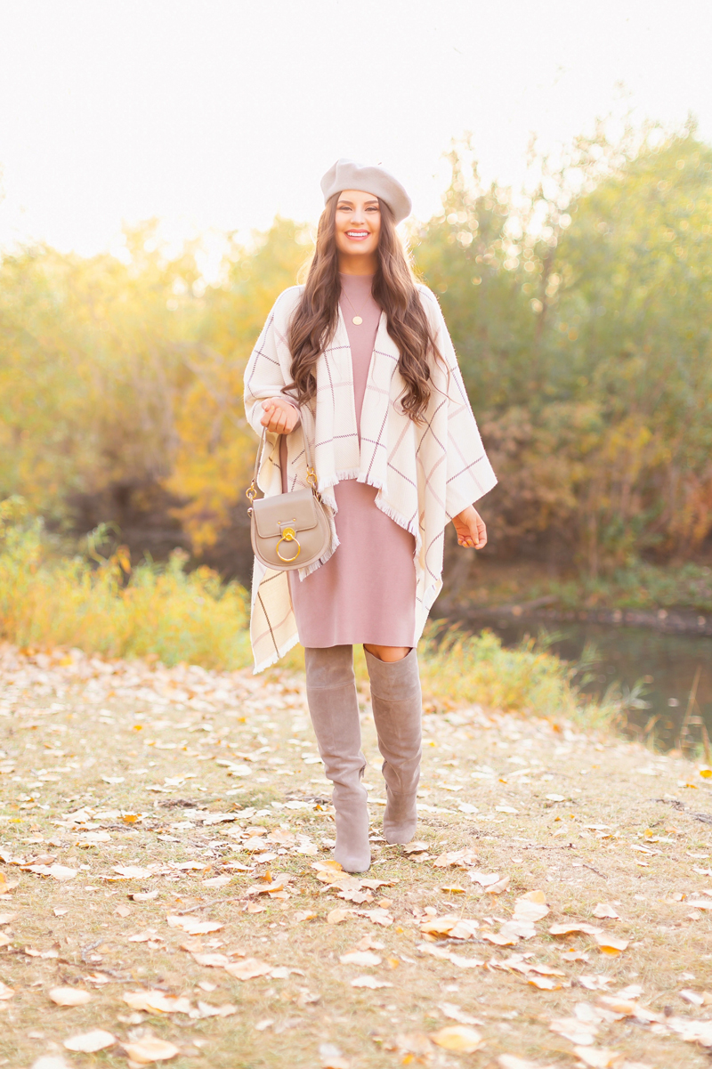 Fall 2020 Lookbook | Ruana Revival | Smiling brunette woman wearing a cream ruana poncho, cotton blush sweater dress, grey beret, grey Chloe Tess bag and grey knee high suede boots | Boho Fall 2020 Outfit Ideas | Fall in Calgary | How to Style a Poncho | Comfortable Fall / Winter Outfit Ideas | Timeless Fall Outfit Ideas | fallwinter 2020 2021 fashion trends | fall 2020 womens fashion trends | Monochromatic Fall Outfit | Calgary Alberta Fashion Blogger // JustineCelina.com