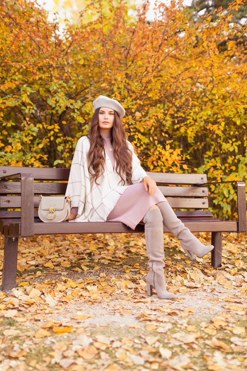 Fall 2020 Lookbook | Ruana Revival | Brunette woman sitting on a park bench surrounded by fall leaves, wearing a cream ruana poncho, cotton blush sweater dress, grey beret, grey Chloe Tess bag, and grey knee high suede boots | Boho Fall 2020 Outfit Ideas | Fall in Calgary | How to Style a Poncho | Comfortable Fall / Winter Outfit Ideas | Timeless Fall Outfit Ideas | fallwinter 2020 2021 fashion trends | fall 2020 womens fashion trends | Calgary Alberta Fashion Blogger // JustineCelina.com