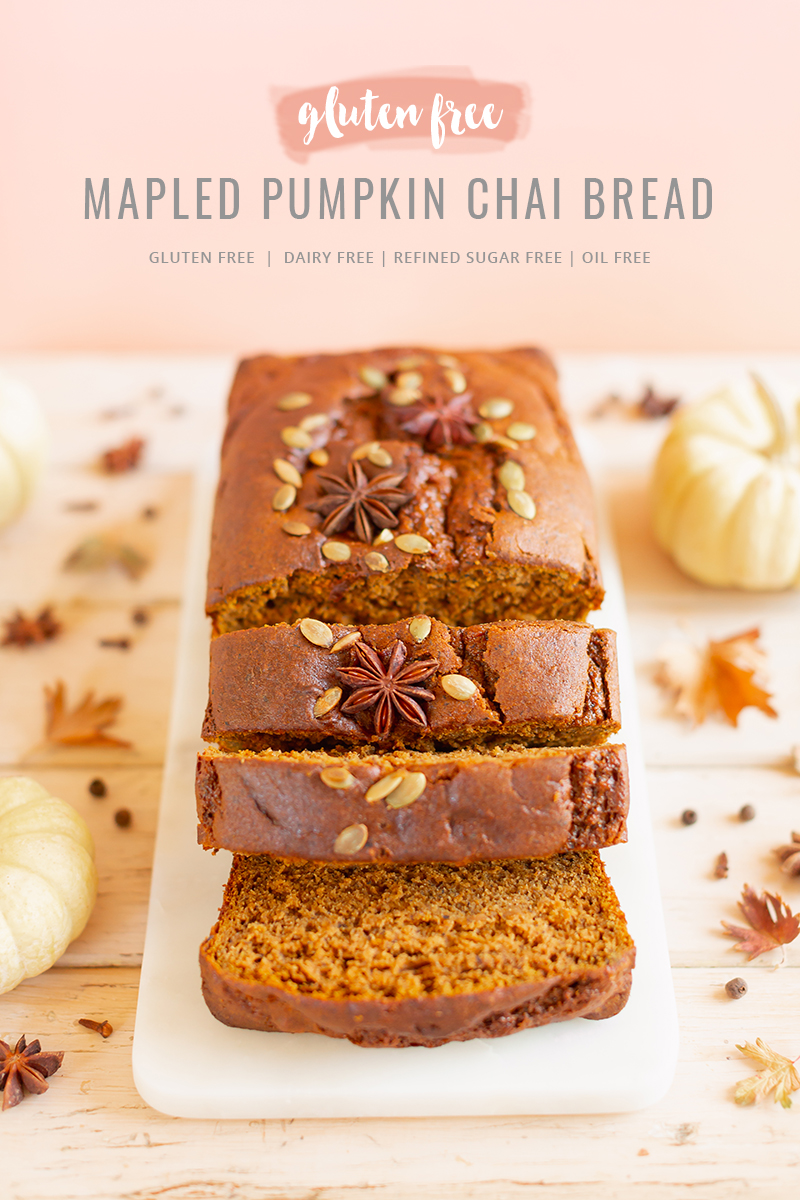 Gluten Free Mapled Pumpkin Chai Bread | Sliced Pumpkin Bread on a Marble Serving Board, served on 2 pink plates with gold forks and a chai latte | Chai Spice Bread styled with spices and white mini pumpkins arranged on blush pink barn board backdrop | Easy Pumpkin Bread | Moist Pumpkin Bread | The Best Gluten Free Fall Baking Recipes | No Sugar Pumpkin Bread | Maple Syrup Pumpkin Bread | Pumpkin Bread Cake | Healthy Pumpkin Bread | Calgary Plant Based Food Blogger // JustineCelina.com
