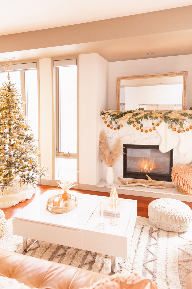 Mid Century Meets Boho Holiday Decor   Bright and airy Mid Century Modern Living Room with a Flocked Christmas Tree and Sputnik Metallic Tree Topper   Boho eucalyptus garland with pampas grass, fresh cedar, bleached Italian ruscus and a beaded dried orange garland   Boho Christmas Decorating Ideas for Apartments   Flocked Christmas Tree with Wood Garland and Boho Ornaments   Holiday Home Tour   Boho Chic Christmas Decor   Glam neutral holiday decor   Boho Christmas Tree // JustineCelina.com