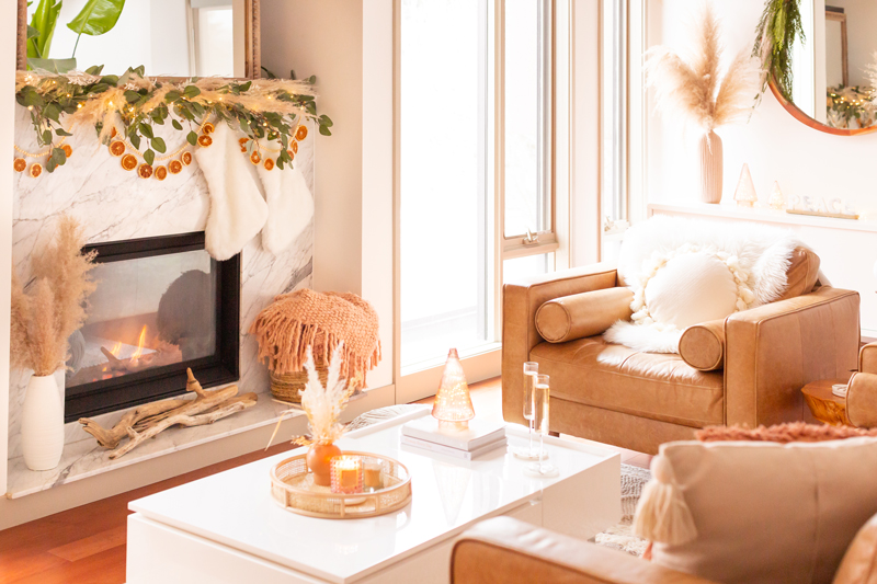 Mid Century Meets Boho Holiday Decor   Bright and airy Mid Century Modern Living Room with a Sheepskin Throw draped over a Structube Kinsey Leather Armchair   Boho Neutral Christmas Decorations   Boho Christmas Decorating Ideas for Apartments   mid century modern christmas images   mid century modern christmas pillows   Warm Neutral Holiday Decor   Holiday Home Tour 2020   Boho Chic Christmas Decor   Glam neutral holiday decor   Boho Christmas Tree // JustineCelina.com
