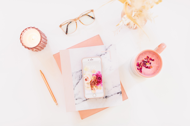 DIGITAL BLOOMS FEBRUARY 2021 | FEBRUARY DIGITAL BLOOMS ROUNDUP | 8 FREE DESKTOP WALLPAPERS | Feminine flatlay on a white desk with blush pink marble journal and planner, a lit candle, a pampas grass arrangement, rose petal latte, blue light glasses and an iPhone featuring JustineCelina's ombre rose wallpaper | Female Entrepreneur Digital Wallpapers | The Best of Justine Celina's February Digital Blooms | Best Valentine's Day Phone Backgrounds | Valentine's Day Flower Wallpaper | Valentines Day Wallpaper iPhone | Calgary Creative Lifestyle Blogger // JustineCelina.com