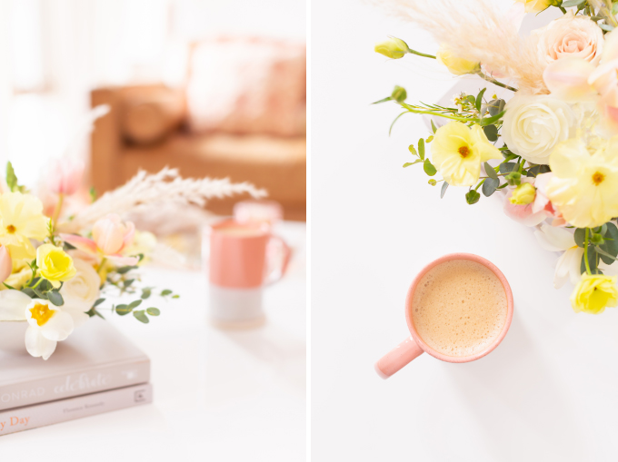 Easter flower arrangement with pampas grass on white coffee table with a pink mug in bright and airy boho living room | Calgary Lifestyle Blogger // JustineCelina.com