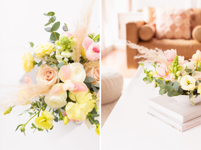 A cheerful spring flower arrangement with pampas grass on white coffee table with a pink mug in bright and airy boho living room | Calgary Lifestyle Blogger // JustineCelina.com