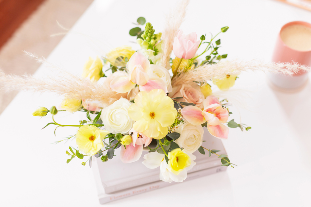 A Pastel Easter Flower Arrangement featuring Quicksand and Spray Roses, Ranunculus and Butterfly Ranunculus, Tulips, Hyacinths, Lisianthus, Eucalyptus, Wax Flowers and Pampas Grass | Calgary Lifestyle Blogger // JustineCelina.com
