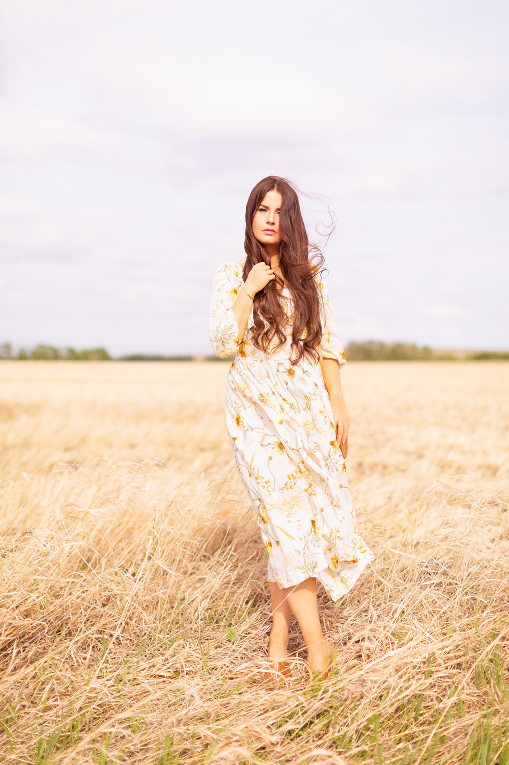 H&M Wildflower Collection Review | Brunette woman wearing a H&M A Meadow of Wildflowers Collection Long Crinkled Dress sitting in a wheat field in the wind | H&M Wildflower Collection Canada | H&M Wildflower Collection Canada | Spring/Summer 2021 Trends | The Best Cotton Dresses 2021 | Boho Spring / Summer Outfit Ideas | The Best H&M Dresses Summer 2021 | Alberta Wildflower Field | Cottage Core Fashion | Cottagecore Outfits | Calgary Creative Lifestyle & Fashion Blogger // JustineCelina.com