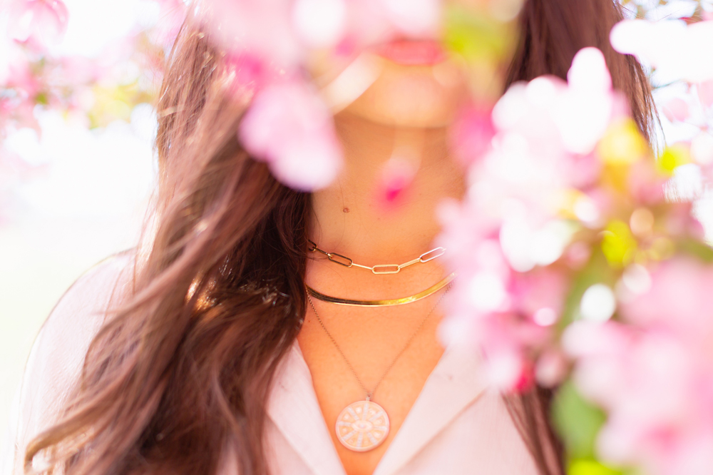 My Joydrop Calgary Jewelry Collection | Brunette woman amongst a blooming cherry blossom tree wearing a Paperclip Necklace, Prima Herringbone Gold Snake Chain Necklace and Gold Coin Pendant Necklace Stack | JustineCelina's Signature Jewelry | Spring / Summer 2021 Jewelry Trends | Necklace Stack Spring / Summer 2021 | How to layer gold necklaces | Jewelry Trends Summer 2021 | The Best Gold Plated Jewelry Canada | Calgary Lifestyle and Fashion Blogger // JustineCelina.com